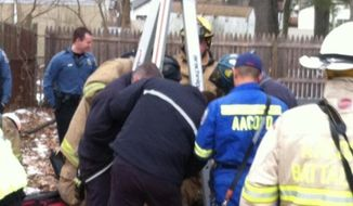 Anne Arundel County firefighters rescue a 10-year-old girl trapped in a 30-foot well on Monday (Photo courtesy of Anne Arundel County Fire Department)