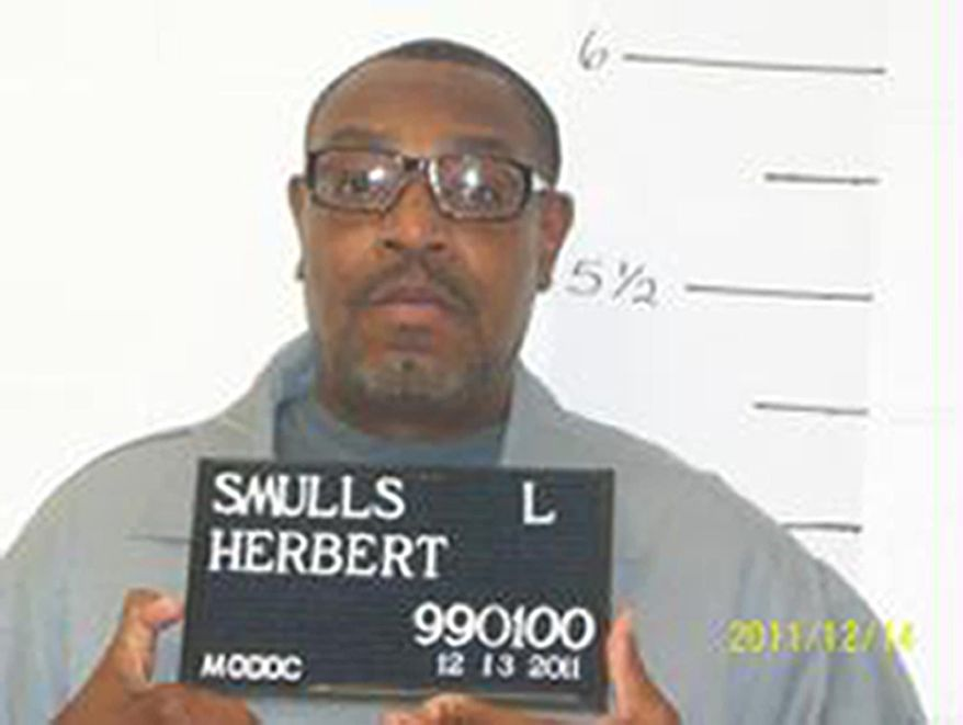 ** FILE ** In this Dec. 13, 2011, file photo released by the Missouri Department of Corrections is death-row inmate Herbert Smulls who was scheduled to die by injection one minute after midnight Wednesday, Jan. 29, 2014, for killing St. Louis County jeweler Stephen Honickman in 1991. The U.S. Supreme Court has granted a stay of execution for the Missouri death row inmate. (AP Photo/Missouri Department of Corrections)