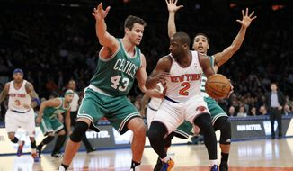 Boston Celtics center Kris Humphries (43) defends New York Knicks guard Raymond Felton (2) in the first half of an NBA basketball game at Madison Square Garden in New York, Tuesday, Jan. 28, 2014.  (AP Photo/Kathy Willens)
