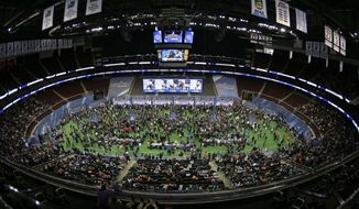 Reporters crowd the floor of the Prudential Center during media day for the NFL Super Bowl XLVIII football game Tuesday, Jan. 28, 2014, in Newark, N.J. (AP Photo/Charlie Riedel)