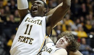 Wichita State forward Cleanthony Early (11) and Evan Wessel (3) go up for a rebound against Loyola in the first half of an NCAA college basketball game on Tuesday, Jan. 28, 2014, in Wichita, Kan. (AP Photo/The Wichita Eagle, Jaime Green) LOCAL TV OUT; MAGAZINES OUT; LOCAL RADIO OUT; LOCAL INTERNET OUT