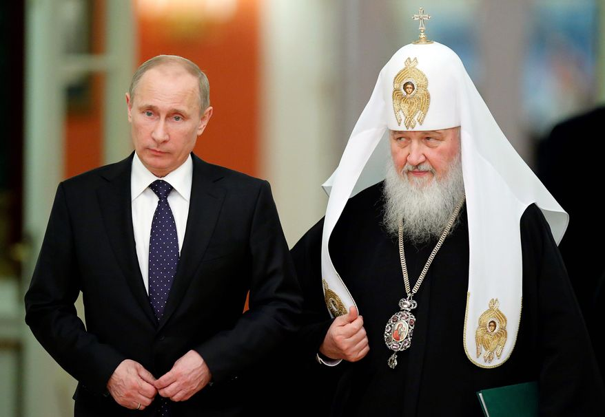 "side by side: Russian Orthodox Church Patriarch Kirill I has echoed President Vladimir Putin's view that Western countries are engaging in a ""spiritual disarmament"" of their people. (Associated Press)"