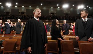 Supreme Court Chief Justice John Roberts arrives for President Barack Obama's State of Union address before a joint session of Congress in the House chamber Tuesday, Jan. 28, 2014. (AP Photo/Larry Downing, Pool)