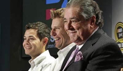 Felix Sabates, right, co-owner of Chip Ganassi Racing with Felix Sabates, laughs with drivers Jamie McMurray, center, and Kyle Larson, left, during a news conference at the NASCAR Sprint Cup auto racing Media Tour in Charlotte, N.C., Tuesday, Jan. 28, 2014. (AP Photo/Chuck Burton)