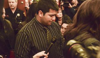 FILE - In this Jan. 24, 2014 file photo, Erick Munoz, husband of Marlise Munoz, is escorted out of court by his attorney Heather L. King, right, in Fort Worth, Texas.  Before Marlise Munoz, a pregnant brain-dead Texas woman was taken off life support over the weekend at the end of a long legal battle, her husband said he decided to name what would have been the couple's second child. Erick Munoz said Monday, Jan. 27,  he gave the 23-week-old fetus the name Nicole, the middle name of his late wife. He would not say why he chose to name the fetus. (AP Photo/Tim Sharp, File)