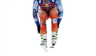 Norway's Aksel Lund Svindal speeds down the course during an alpine ski, men's World Cup downhill, in Kitzbuehel, Austria, Saturday, Jan. 25, 2014. (AP Photo/Shinichiro Tanaka)