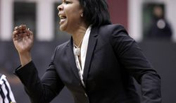 Temple coach Tonya Cardoza calls a play against Connecticut in the first half of an NCAA college basketball game, Tuesday, Jan. 28, 2014, in Philadelphia. Connecticut won 93-56.(AP Photo/H. Rumph Jr.)