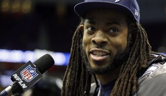 Seattle Seahawks' Richard Sherman answers a question during media day for the NFL Super Bowl XLVIII football game Tuesday, Jan. 28, 2014, in Newark, N.J. (AP Photo/Jeff Roberson)