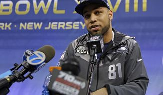 Seattle Seahawks' Golden Tate answers a question during media day for the NFL Super Bowl XLVIII football game Tuesday, Jan. 28, 2014, in Newark, N.J. (AP Photo/Jeff Roberson)