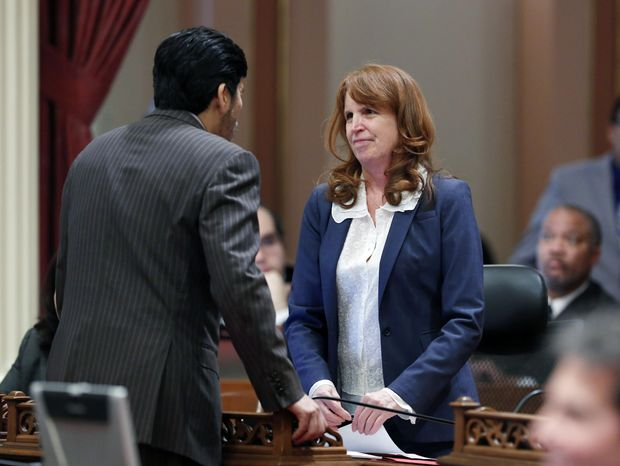 State Sen. Noreen Evans, D-Santa Rosa, right, talks with Sen. Kevin de Leon,  after the Senate approved Evans measure that would limit the number of prospective jury members during the Senate session a the Capitol in Sacramento, Calif., Tuesday, Jan. 28, 2014. Prosecutors and defense attorney would be able to reject fewer jurors in misdemeanor trials under Evans bill, SB794 that was approve by the Senate Tuesday.  Current