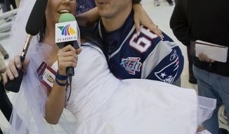 "File-This Jan. 29, 2008 file photo shows Ines Gomez Mont, a reporter from TV Azteca in Mexico, wearing a wedding dress as she is carried by New England Patriots center Lonie Paxton while interviewing him during media day for the Super Bowl XLII football game in Glendale, Ariz.  Once a serious endeavor, media day is now a forum for credentialed ""media"" such as Mont. The entertainment reporter for Mexico's TV Azteca showed up in Glendale, Ariz., wearing a scanty white wedding dress and towering red pumps. She spent the next two hours trying to persuade someone, anyone, to accept her marriage proposal. (AP Photo/The Arizona Republic, Michael Chow, File)"