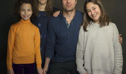 """In this Sunday, Jan. 19, 2014 photo, from left, actress Ashley Aufderheide, director Maya Forbes, actor Mark Ruffalo and actress Imogene Wolodarsky of the film, """"Infinitely Polar Bear,"""" pose for a portrait at The Collective and Gibson Lounge Powered by CEG, during the Sundance Film Festival, in Park City, Utah. The film premiered at the 2014 Sundance Film Festival. (Photo by Victoria Will/Invision/AP)"""