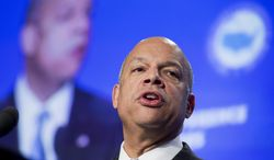 FILE - In this Jan. 24, 2014, file photo, Homeland Security Secretary Jeh Johnson speaks at the U.S. Conference of Mayors 82nd Winter Meeting in Washington. Johnson, who had little experience with immigration policy before he was appointed, has outlined for the first time his approach on the subject. He described an earned path to citizenship for the roughly 11 million immigrants living in the United States illegally as a matter of national security. (AP Photo/Manuel Balce Ceneta, File)