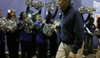 Seattle Seahawks head coach Pete Carroll smiles as he arrives for media day for the NFL Super Bowl XLVIII football game Tuesday, Jan. 28, 2014, in Newark, N.J. (AP Photo/Jeff Roberson)