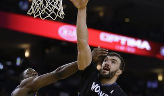 Minnesota Timberwolves' Nikola Pekovic (14) shoots over Golden State Warriors' Harrison Barnes, left, during the second half of an NBA basketball game Friday, Jan. 24, 2014, in Oakland, Calif. (AP Photo/Ben Margot)