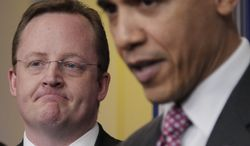 **FILE** President Barack Obama, right, acknowledges outgoing White House Press Secretary Robert Gibbs, left, during the daily news briefing at the White House in Washington, Friday, Feb., 11, 2011. Gibbs stepped down from the post after two years as Obama's top spokesman. (AP Photo/Carolyn Kaster)