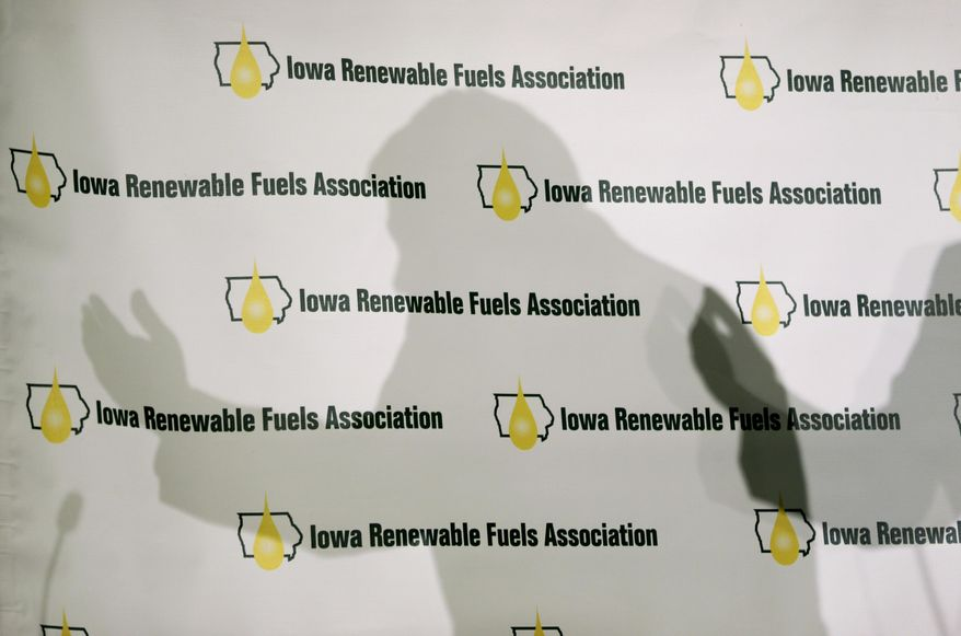 Iowa Gov. Terry Branstad casts a shadow on a backdrop as he speaks during the Iowa Renewable Fuels Association Summit, Tuesday, Jan. 28, 2014, in Altoona, Iowa. Branstad says he feels momentum is with Iowa and other farm states pushing the EPA to reverse a plan to cut the amount of biofuels blended into gasoline this year. (AP Photo/Charlie Neibergall)