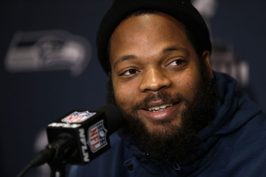 Seattle Seahawks defensive end Michael Bennett smiles as he listens to a question during a news conference Monday, Jan. 27, 2014, in Jersey City, N.J. The Seahawks and the Denver Broncos are scheduled to play in the Super Bowl XLVIII football game Sunday, Feb. 2, 2014. (AP Photo/Jeff Roberson)