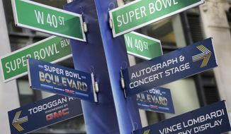 Street signs for Super Bowl Boulevard point to attractions, Tuesday, Jan. 28, 2014 in New York's Times Square.  Thirteen blocks of midtown Manhattan have been converted into a temporary festival space leading up to the National Football League's championship game between the Seattle Seahawks and the Denver Broncos on  Sunday, Feb. 2, in East Rutherford, N.J. (AP Photo/Mark Lennihan)