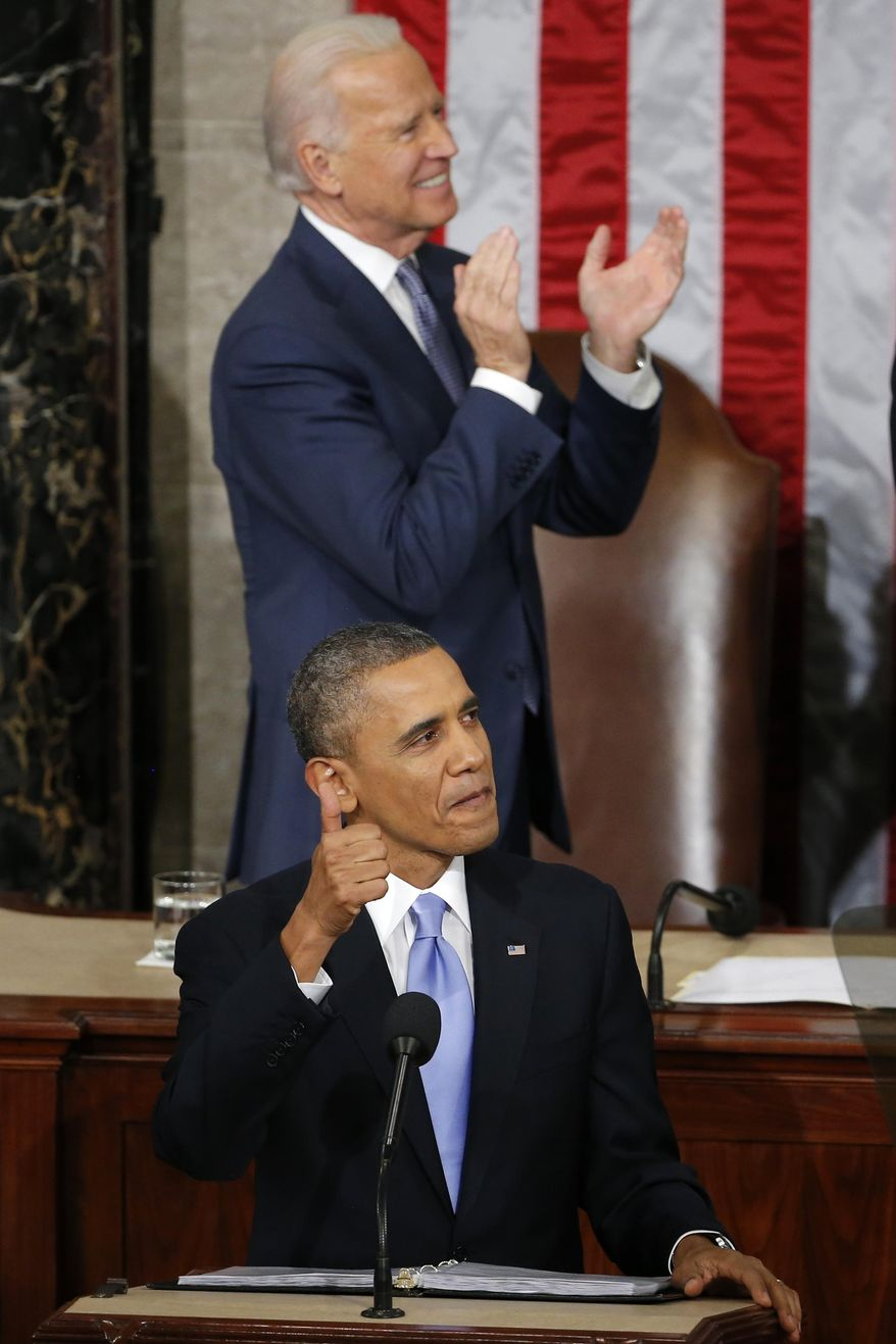 President Barack Obama gives a thumbs-up and Vice President Joe Biden applauds Army Ranger 1st Class Cory Remsburg during the president's State of the Union address on Capitol Hill in Washington, Tuesday Jan. 28, 2014. (AP Photo/Charles Dharapak)