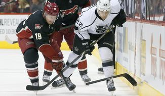 Phoenix Coyotes' Shane Doan (19) gets his stick broken by Los Angeles Kings' Trevor Lewis (22) during the first period of an NHL hockey game Tuesday, Jan. 28, 2014, in Glendale, Ariz. (AP Photo/Ross D. Franklin)