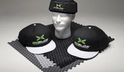 This product image released by Vizion Group on Tuesday, Jan. 28, 20134, shows the isoBLOX protective caps, for professional baseball players, left and right, and a youth level protective skull cap, center, for under a standard fielder's cap, set atop sheets of the actual protective material, uniquely-formulated plates that use a combination of dispersion and absorption techniques to diffuse energy upon impact with a high-velocity object. Major League Baseball has approved the protective cap for pitchers to reduce the effects of being hit in the head by line drives. (AP Photo/Vizion Group)