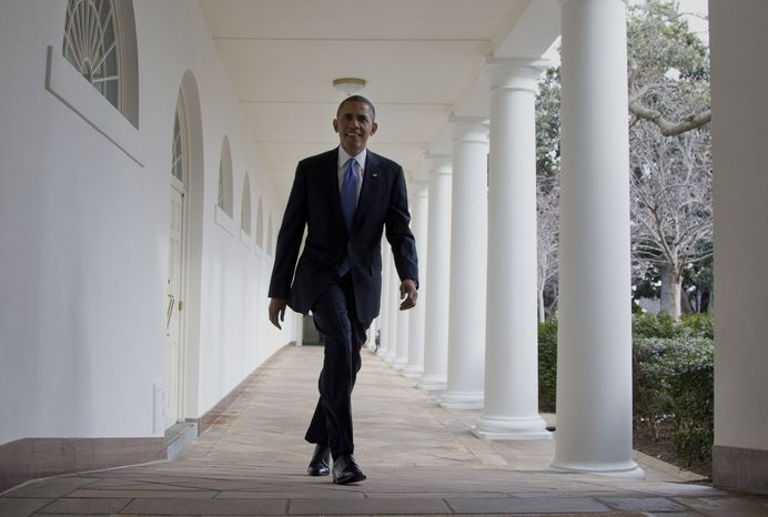 President Barack Obama walks along the Colonnade at the White House in Washington, Tuesday, Jan. 28, 2014, hours before giving his State of the Union Address before a joint session of Congress. (AP Photo/Carolyn Kaster)