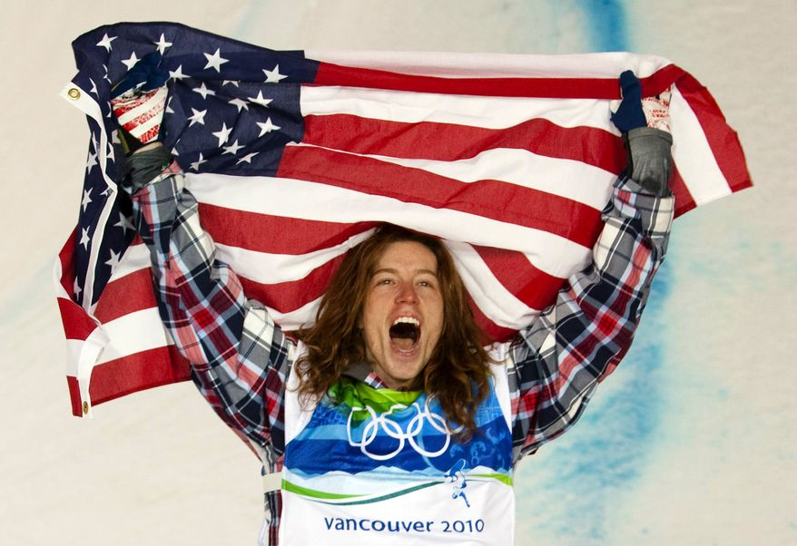 """FILE - In this Feb. 17, 2010, file photo, Shaun White, of the United States, celebrates his gold medal in the men's snowboard halfpipe finals at Cypress Mountain in West Vancouver, Brtish Columbia, at the 2010 Vancouver Olympic Winter Games. White heads to the Sochi winter Olympics as arguably the most famous athlete competing: """"It's going to push me to do things I never would've done before,"""" he says. (AP Photo/The Canadian Press, Sean Kilpatrick, File)"""