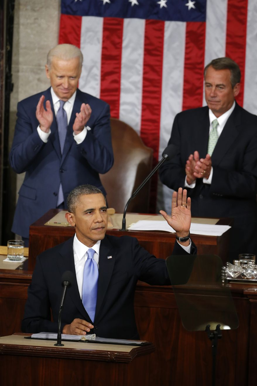 President Barack Obama waves before giving his State of the Union address on Capitol Hill in Washington, Tuesday Jan. 28, 2014. Vice President Joe Biden and House Speaker John Boehner of Ohio applaud behind the president. (AP Photo/Charles Dharapak)