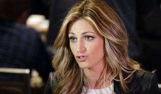 Erin Andrews speaks during an interview at the NFL Super Bowl XLVIII media center, Tuesday, Jan. 28, 2014, in New York. (AP Photo/Matt Slocum)