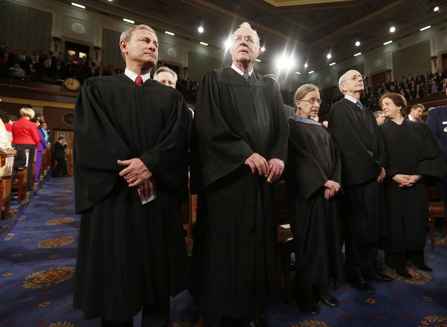 U.S. Supreme Court Chief Justice John Roberts (L) stands with fellow Justices Anthony Kennedy (2nd from L), Ruth Bader Ginsburg, Stephen Breyer and Elena Kagan (R) prior to President Barack Obama's State of the Union speech on Capitol Hill in Washington, January 28, 2014.  REUTERS/Larry Downing (UNITED STATES  - Tags: POLITICS)