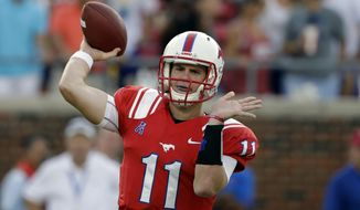 FILE - IN this Aug. 30, 2013, file photo, SMU quarterback Garrett Gilbert throws a pass during the first half of an NCAA college football game against Texas Tech in Dallas. Four months after relaunching his sports agency, Leigh Steinberg has signed Gilbert as his first football client. (AP Photo/LM Otero, File)