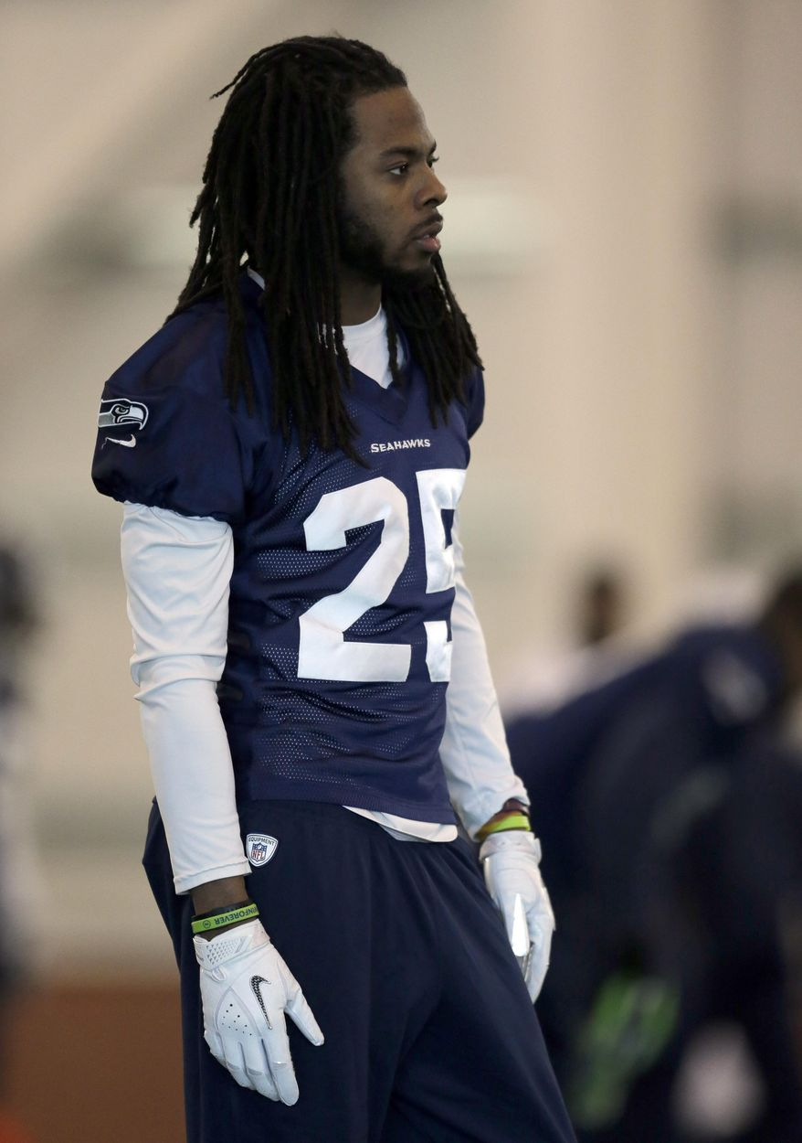 Seattle Seahawks cornerback Richard Sherman warms up at the start of NFL football practice Wednesday, Jan. 29, 2014, in East Rutherford, N.J. The Seahawks and the Denver Broncos are scheduled to play in the Super Bowl XLVIII football game Sunday, Feb. 2, 2014. (AP Photo/Jeff Roberson)