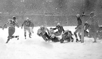 FILE- In this Dec. 1948, file photo, Philadelphia Eagles' Steve Van Buren (15) plunges over the goal line for a  touchdown during the fourth quarter of the NFL championship game against the Chicago Cardinals in the driving snowstorm in Philadelphia. The Eagles won 7-0 (AP Photo/File)