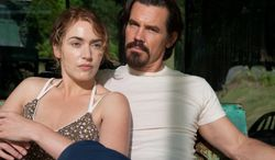 """This image released by Paramount Pictures shows Kate Winslet, left, Josh Brolin in a scene from """"Labor Day."""" (AP Photo/Paramount Pictures, Dale Robinette)"""