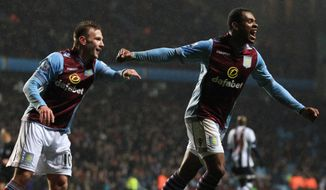 Aston Villa's Leandro Bacuna, right, celebrates scoring the second goal, during the English Premier League match against West Bromwich Albion, at Villa Park, Birmingham, England, Wednesday Jan. 29, 2014. (AP Photo/PA, Nick Potts) UNITED KINGDOM OUT