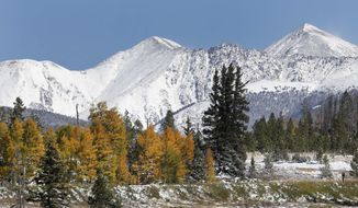 """In this Oct. 5, 2013 file photo, fresh snow covers Torreys Peak, right, and Grizzly Peak, left, east of Frisco, Colo. In the run up to the Super Bowl between the Broncos and the Seahawks, Colorado Gov. John Hickenlooper announced Wednesday, Jan. 29, 2014  that he's temporarily re-naming Colorado's highest mountains for each member of the Denver Broncos. The state is home to more than 50 mountains over 14,000 feet, called """"14-ers"""" by locals. Torreys Peak has been named after Broncos wide receiver Demaryius Thomas. (AP Photo/Brennan Linsley, File)"""