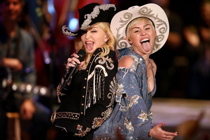 "Miley Cyrus performs with Madonna for MTV Tuesday Jan. 28, 2014. The 21-year-old pop star and the 55-year-old Queen of Pop grinded and grabbed each other as they performed Cyrus' hit ""We Can't Stop"" and Madonna's 2000 track ""Don't Tell Me""  Tuesday during"