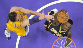 Indiana Pacers guard Lance Stephenson, right, goes up for a dunk as Los Angeles Lakers center Pau Gasol, of Spain, defends during the first half of an NBA basketball game, Tuesday, Jan. 28, 2014, in  Los Angeles. (AP Photo/Mark J. Terrill)
