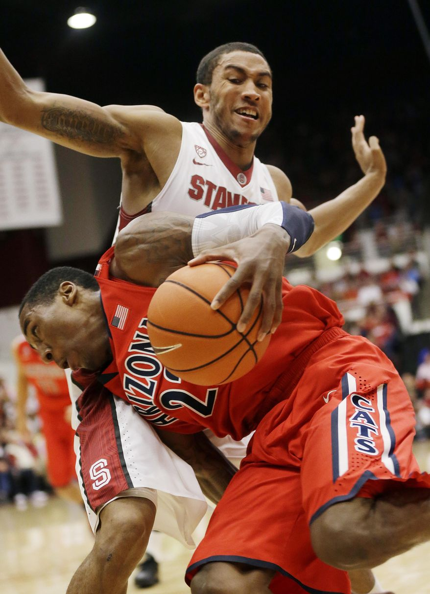 Arizona's Rondae Hollis-Jefferson, front, is defended by Stanford forward Josh Huestis during the first half of an NCAA college basketball game on Wednesday, Jan. 29, 2014, in Stanford, Calif. (AP Photo/Marcio Jose Sanchez)