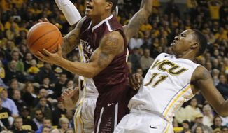Fordham's Chris Whitehead draws a foul from VCU's Rob Brandenberg (11) during an NCAA college basketball game Wednesday, Jan. 29, 2014, in Richmond, Va. (AP Photo/Richmond Times-Dispatch, Joe Mahoney)