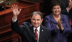 Gov. Gary Herbert waves to the crowd after delivering his fifth annual State of the State address Wednesday, Jan. 29, 2014, in Salt Lake City. Herbert detailed his priorities for 2014 after making air quality and education high-profile issues in his proposed $13.3 billion budget.  (AP Photo/Rick Bowmer)