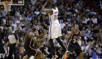 Oklahoma City Thunder small forward Kevin Durant (35) shoots against Miami Heat small forward LeBron James (6) and guard Ray Allen (34) during the second period of an NBA basketball game in Miami, Wednesday, Jan. 29, 2014. (AP Photo/Alan Diaz)