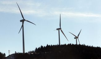 In this photo taken Tuesday Jan. 28, 2014 wind turbines are seen in Rumney, N.H. On Wednesday Jan. 29, 2014 New Hampshire lawmakers defeated a temporary ban on new wind turbines and electric transmission line projects.(AP Photo/Jim Cole)