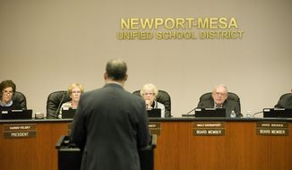 Karen Yelsey, from left, Martha Fluor, Judith Franco, Walt Davenport and David Brooks, all members of the Newport-Mesa Unified School District board, listen to Dennis Ashendorf in a public comments meeting on Tuesday, Jan. 28, 2014 in Costa Mesa, Calif.  The school board voted after a lengthy late-night session to punish 11 students accused of hacking into computers at the wealthy public high school to access tests and change grades. The Newport-Mesa Unified School District board deliberated for hours and emerged shortly after midnight Wednesday to announce it had decided to approve all the recommendations from administrators at Corona del Mar High School.  Many of those recommendations involve punishment that is less severe than an expulsion, but the district could not give further specifics on the discipline, citing confidentiality rules, (AP Photo/The Orange County Register, Rod Veal)   MAGS OUT; LOS ANGELES TIMES OUT