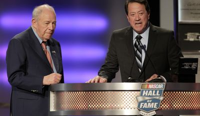 Former driver Jack Ingram stands silently as he is introduced by fellow driver Harry Gant during the NASCAR Hall of Fame Induction Ceremony, Wednesday, Jan. 29, 2014, in Charlotte, N.C. (AP Photo/Bob Leverone)
