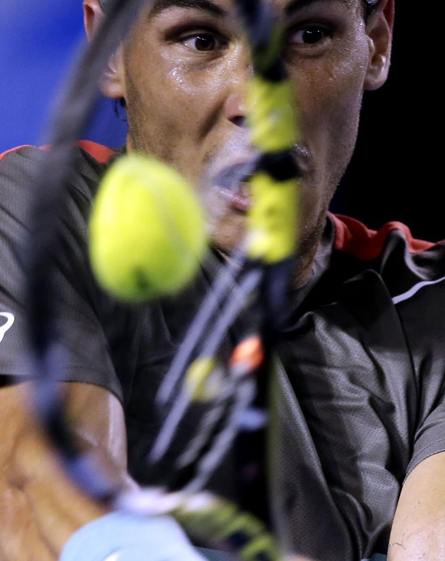 10ThingstoSeeSports - Rafael Nadal, of Spain, makes a backhand return to Roger Federer, of Switzerland, during their semifinal at the Australian Open tennis championship in Melbourne, Australia, Friday, Jan. 24, 2014. (AP Photo/Rick Rycroft, File)