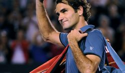Roger Federer of  Switzerland walks off the Rod Laver Arena after his semifinal loss to Rafael Nadal of Spain during their semifinal at the Australian Open tennis championship in Melbourne, Australia, Friday, Jan. 24, 2014.(AP Photo/Andrew Brownbill)