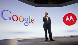 ** FILE ** In this Wednesday, Sept. 5, 2012, file photo, Eric Schmidt, Google's chairman, speaks during a press conference in New York, where Motorola introduced three new smartphones, the first since it became a part of Google. (AP Photo/Bebeto Matthews, File)