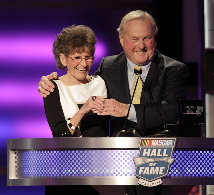 Francis Flock, left, widow of inductee Tim Flock, laughs with former manager of the Charlotte Motor Speedway, H.A. Humpy Wheeler who presented her with the her late husband's hall of fame ring during the NASCAR Hall of Fame Induction Ceremony, Wednesday, Jan. 29, 2014, in Charlotte, N.C. (AP Photo/Bob Leverone)